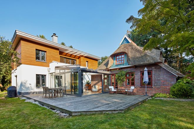 Planung nach Maß: Der Wintergarten verbindet den Altbau stilvoll mit dem Neubau.